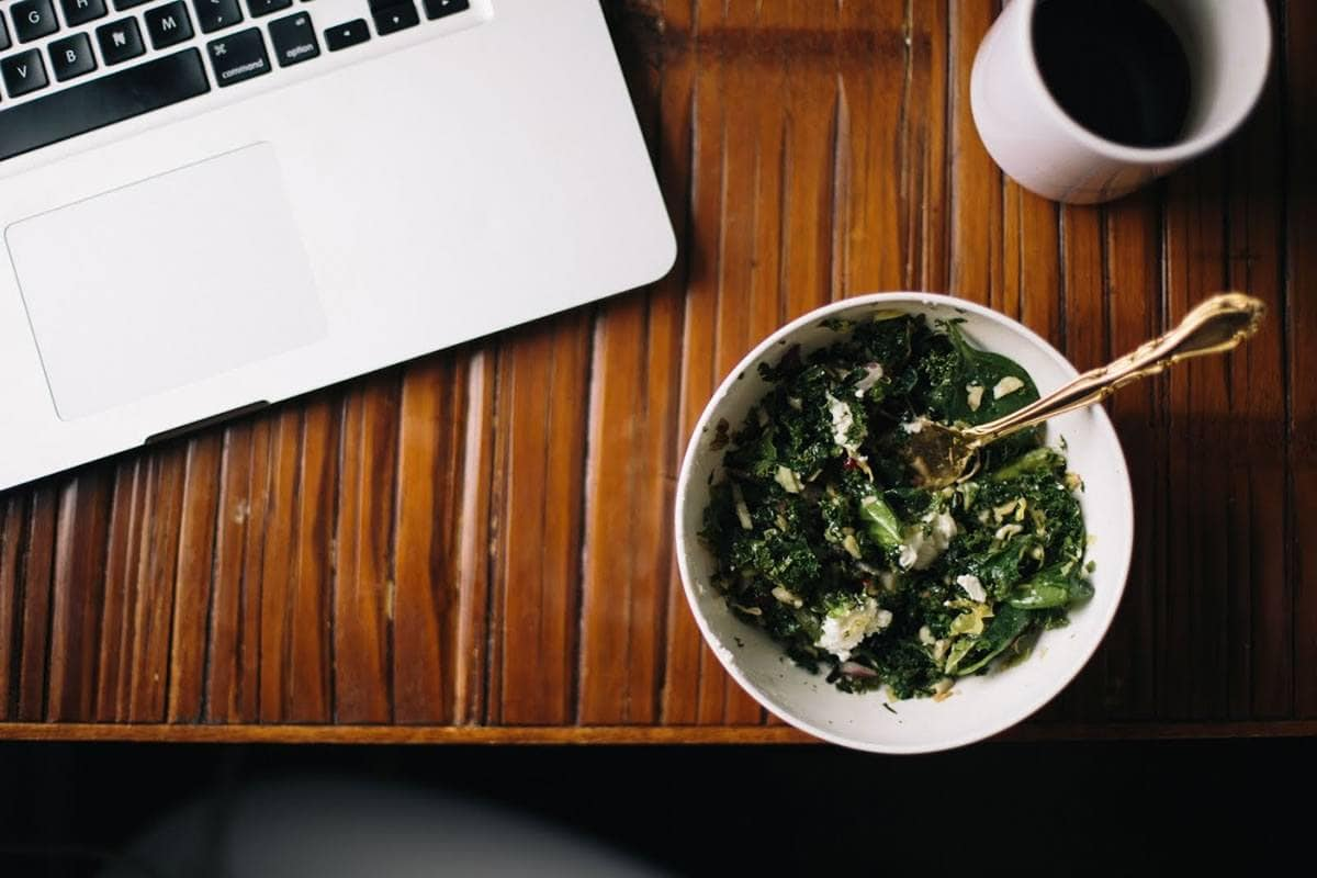 Corporate Wellness laptop and eating at desk
